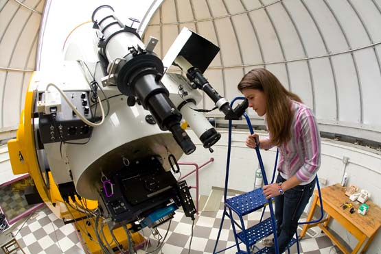 student at telescope